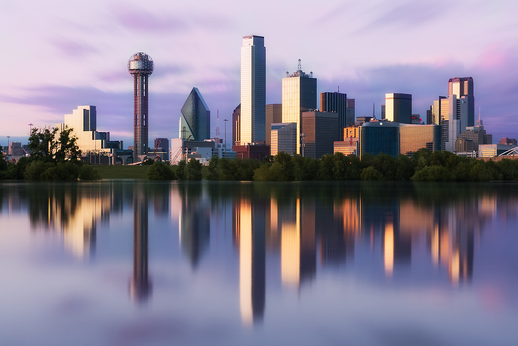 The downtown Dallas, Texas skyline reflects in a flooded Trinity River on May 24, 2015.