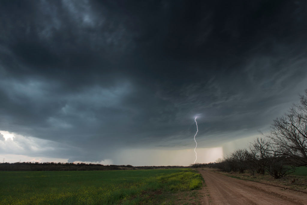 A supercell thunderstorm with a wall cloud and cloud-to-ground lightning just south of Throckmorton, Texas.