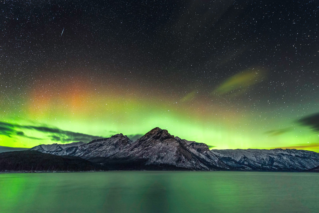 The aurora borealis dances above Lake Minewanka in Banff National Park in Alberta, Canada in November, 2014.