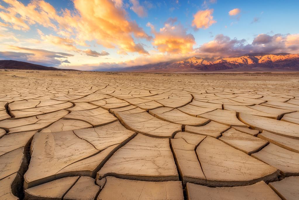 Mud cracks in Death Valley National Park at sunrise.