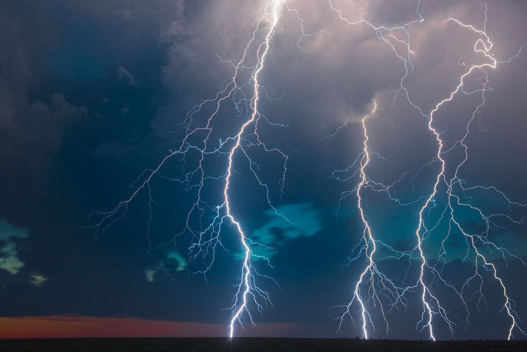 Multiple cloud-to-ground lightning bolts strike down at sunset from a supercell near Throckmorton, Texas on April 23, 2014.