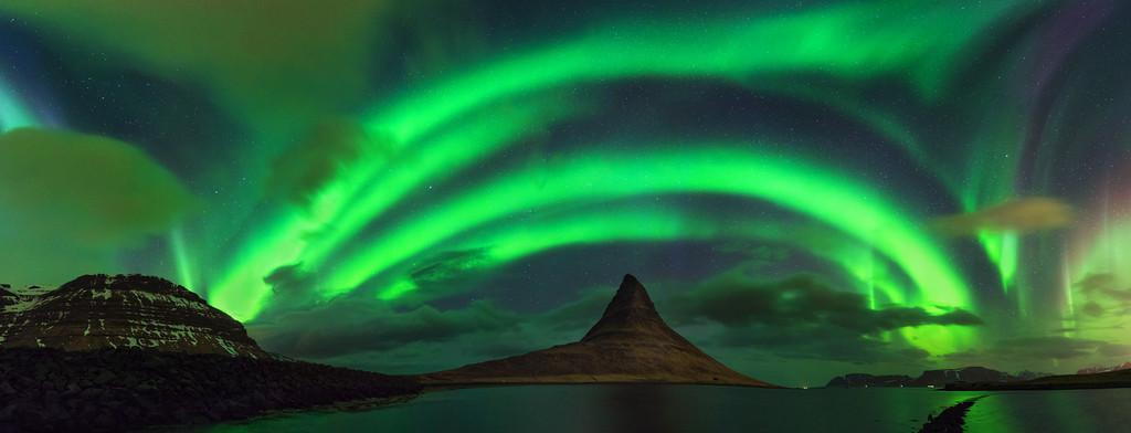 Kirkjufell in Iceland below the northern lights.
